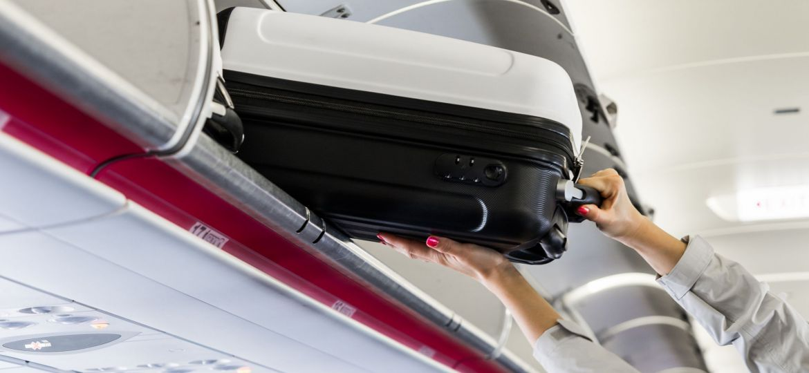 woman-taking-her-hand-luggage-in-airplane-picjumbo-com